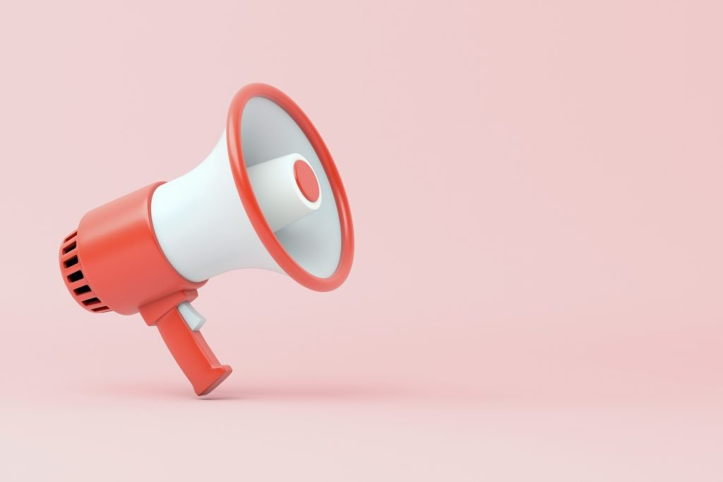 An animated red megaphone on a pink background representative of video marketing